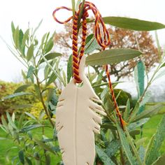 My custom skinny bracelets aren't just for wrists! This one made the perfect addition to a homemade feather garden ornament :D
