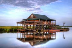 This fish camp sites deep in Lake Hermitage Bayou in Louisiana's southern most parish, Plaquemines Parish.