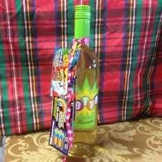 Mini clothespins clip lottery tickets onto a bottle of Lotto Moscato. The perfect gift for anyone!