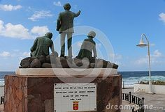 Statue of three poets of Gran Canaria who visited Puerto de las Nieves.  From left: Saulo Toron, Tomas Morales and Alonso Quesada. Back view.