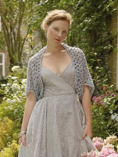 This gorgeous shrug with a lattice stitch detail is an ideal pull on for those beautiful summer days.