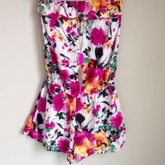 Bright Floral Romper Perfect for summer! Super light-weight fabric. I bought this at a boutique (not Anthro) but wanted it to get views because it's so cute! Great condition! Anthropologie Dresses