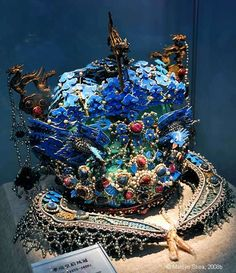 Phoenix crown worn by the Ming Dynasty Empress Xiaoduan. She was the wife of Emperor Wanli who reigned from 1573 to 1620. The enameled crown is decorated with pearls and turquoise. There is another view on the next page.