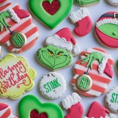 These wonderful Grinch Who Stole Christmas Cookies were made for a birthday party by Sugar Cookie Wasted. The cookies include the Grinch wearing a Santa ha Grinch Christmas Decorations, Cute Christmas Cookies, Grinch Christmas Party, Grinch Who Stole Christmas, Christmas Baby Shower, Christmas Goodies, Holiday Cookies, Christmas Treats, Christmas Baking
