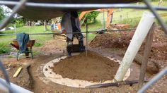 Soil is put on top of the plywood base to start the dome for the biodigester
