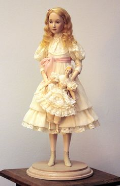 by Alexandra Koukinova // Glasha // Biscuit porcelain. Silk crushed chiffon, traditional French laces. Footwear is made of natural suede. Wig – real mohair.  The small doll is made of porcelain. A suit - French laces and natural silk.
