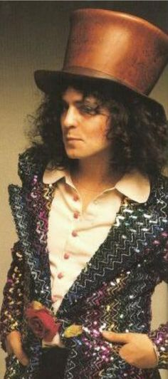 MARC BOLAN star of T.Rex never cut or straightened his corkscrew curls. Even after he became a father. What a dandy!