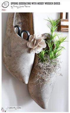 Spring decorating with mossy wooden shoes as wall art - via FunkyJunkInteriors.net