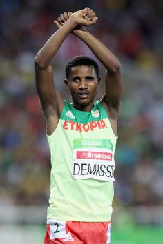 Tamiru Demisse of Ethiopia makes a gesture of solidarity with the Oromo in his country after the men's 1500 meter T13 final at Olympic Stadium during day 4 of the Rio 2016 Paralympic Games on September 10, 2016 in Rio de Janeiro, Brazil.
