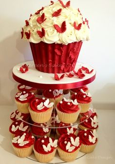 Giant Cupcake Tower Made for a lady turning 70 and she wanted red/white butterfly contrast. The bottom of my giant cupcake is a chocolate. Big Cupcake, Giant Cupcake Cakes, Wedding Cakes With Cupcakes, Cupcake Ideas, Cupcake Images, Chocolate Giant Cupcake, Chocolate Shells, Cake Pops, Cake Smash