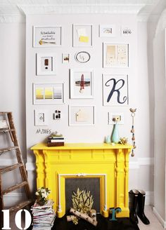 Love the yellow fireplace against the white wall as well as the white frames. White trim on lower part of the walls