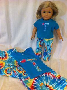 Custom girl and doll pj set. Flannel pants and knit shirts with their initial. Comes in a variety of colors and sizes, $40.