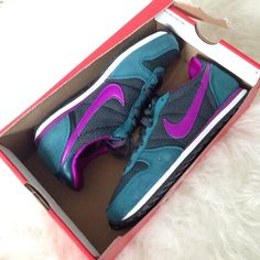 Nike Sneakers A new never worn pair of Nike old school style sneakers. Size 6.5. With box! It's just the top is cut off like in the picture. In a beatific and unique purple and teal seaweed color. Nike Shoes Sneakers
