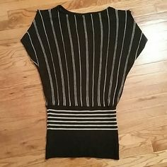 Beautiful too Black top, sliver stripes with shimmer. Has an opening on each shoulder, with a shiny sliver button. Wet Seal Tops