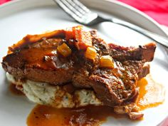 Cider-Braised Country-Style Pork Ribs With Creamy Mashed Potatoes:  Inexpensive, country-style pork ribs are braised in a base that's spiked with Dijon, vinegar and apple cider and then served atop creamy mashed potatoes.