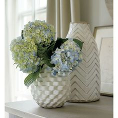 Boldly patterned African textiles emerge dimensional and geometric in faceted terra cotta vase. Crisp white glaze brings hand-carved texture into sculptural relief, while exposed clay at top and bottom add rustic contrast. Crate And Barrel, Hydrangea Care, Hydrangeas, White Texture, White Vases, Vases Decor, Plant Holders, Decorating Tips, Condo Decorating
