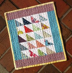 She has written several delightful books of small quilts and uses one of her patterns each month as a challenge.