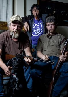 Red-neck Family Portait. The shot guns and pipes were a nice touch.