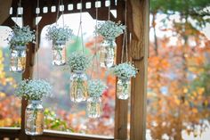 Baby's Breath in different size mason jars as back drop