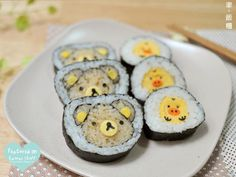 I think that's supposed to be a duck on the right... maybe a chick.. but it does seem to have a pig's nose...either way it's still cute for sushi ^^