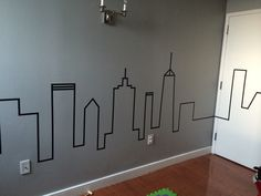 The finished product! My modern baby/toddler bedroom! Washi tape skyline. City themed bedroom. Modern boys bedroom.  DIY boys bedroom. NYC bedroom. Cityscape bedroom.