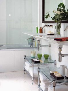 Bathroom Organizing Storage using industrial shelving and glass tops. Classic looking and clean lines.