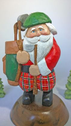 A Slice of Holiday - A hand-carved Santa with golfing bag, attire and clubs