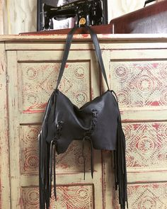 A personal favorite from my Etsy shop https://www.etsy.com/listing/263195079/fun-fringe-lace-up-hobo-bag-gypsy-bag