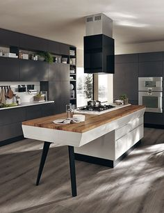The Scavolini Motus marries a sleek, minimalist base with a top in reclaimed oak; price upon request. scavolini.com