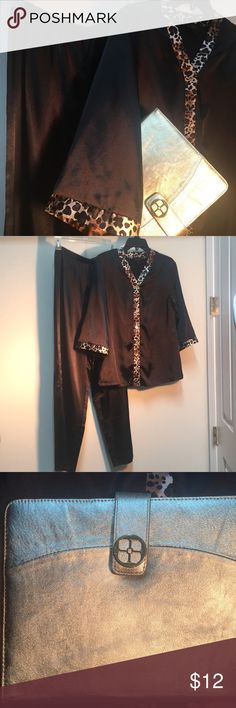 """IMAN Designer PJ's & IPad Case Black/Cheeta Satin Elegant PJ's, says size XS, but could fit a small as measures 19"""" armpit to armpit and approx 25"""" long, pants are 30"""" long inseam. Pants have (what looks like a manufacturing flaw), but isn't really noticeable with the shiny material and the top covers it as well. Comes with an IMAN Leather Metallic Gold IPad/Laptop approx 9-1/2""""by 7-1/2"""" Cover-Case. Both items Gently Used in good condition. Intimates & Sleepwear Pajamas"""