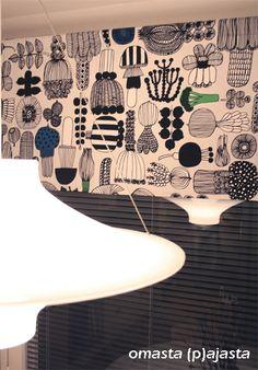 Marimekko Puutarhurin parhaat fabric (made into a blind curtain) in a Finnish kitchen.