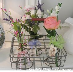 Flower Holder Bed Springs ~ love this in the wire basket. Use tall skinny vases or shot glasses to keep flowers fresh in water, just post the spring over the vase!
