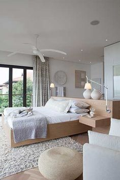 Michele Throssell Interiors > Beach house > Laid back, casual, comfortable textured interiors > Interior design > main bedroom > grey & off white, neutral interior colours > freestanding bleached oak headboard & base > shaggy rug