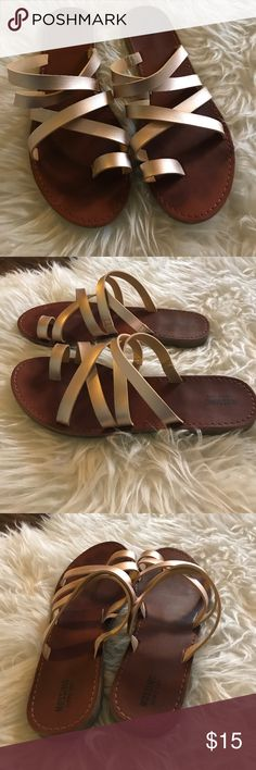 Mossimo rose gold sandals Adorable Mossimo sandals. Strappy across top with a single toe strap. Only wear is a piece peeled on inside of toe but not noticeable. Size 9. Mossimo Supply Co Shoes Sandals