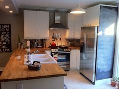 white cabinets, butcherblock counter