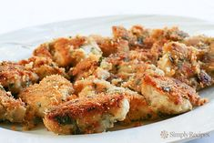 BEST Parmesan Chicken Breast recipe ever! Chicken parts dipped in melted butter, dredged in bread crumbs and Parmesan, and baked until crisp. Parmesan Chicken Breast Recipe, Chicken Parmesan Recipes, Baked Chicken Breast, Chicken Breasts, Homemade Chicken Nuggets, Chicken Nugget Recipes, Nuggets Recipe, Simply Recipes, Carne