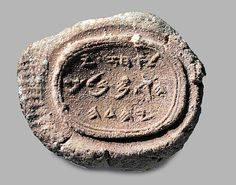 "This clay seal impression from the 8th century BC contains the Hebrew text, ""Belonging to Ahaz [son of] Jehotam, King of Judah."" Ahaz was a Biblical king referred to in the books of 2 Kings and Isaiah. Fingerprints can be seen on the left side of the impression, possibly those of Ahaz himself. The artifact is roughly one-half inch in size and is now in a private collection."