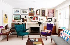 Wide gallery style wall creates warmth and depth in this room. You almost don't notice how short the ceiling is.