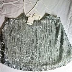 Piperline glitter top Brand new with tags from Piperlime , Glamorous glitter top. The size is a large. It is very drapey and will easily fit an xl as well. It has white straps that criss cross in back. The front and back are silver sequins . This top is super fancy  and sexy. Piperlime Tops