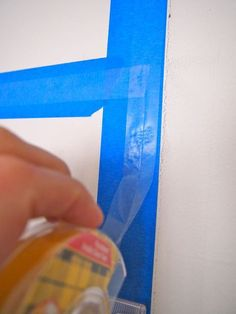 Painters tape, then double sided tape to hang posters and such without peeling paint off walls or putting thumbtack holes in walls. SUCH a clever idea!
