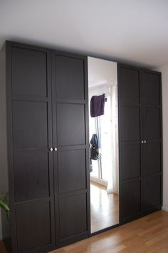 IKEA Pax bedroom wardrobe hack to look like custom wardrobe. Description from pinterest.com. I searched for this on bing.com/images