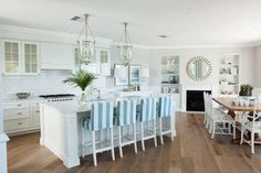 Pretty beach house kitchen / dining with coastal tones.   Hamptons charm in Queensland
