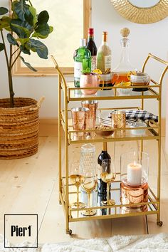 Load it up and announce the serve-yourself bar is open. Part party planner and part bartender, our Gold Square Bar Cart looks fittingly festive blinged out with shiny metallic glassware, candle holders and more. Diy Bar Cart, Gold Bar Cart, Bar Cart Decor, Bar Carts, Ikea Bar Cart, Plywood Furniture, Bar Furniture, Bar Designs, Kitchen Designs