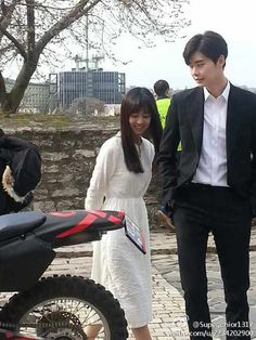 Lee Jong Suk looks so so tall here besides Jin Se Yeon, filming Doctor Stranger in Budapest
