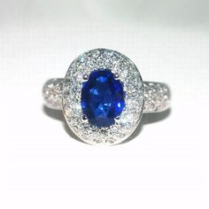 18K gold ring set with a regal 1.66ct blue sapphire and .80ct diamonds.