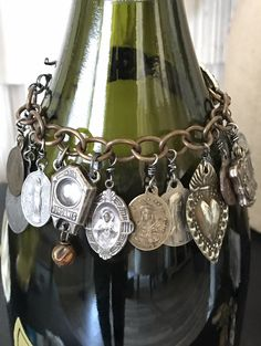Alpha Female Studio exclusive: Sacred Heart Milagros, Charm Bracelet, Antique Religious Medals, Vintage Rhinestones #etsy #jewelry #bracelet #charmbracelet #gothic #vintagemedals #antiquemedals #religious #assemblagejewelry #alphafemalestudio