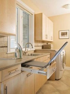 Pullout ironing board laundry room