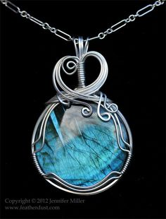 This is a Labradorite carefully hand wrapped in Argentium sterling silver. This round piece is so cool! I love the arcing striations in it that really m. Echoes of Neptune Labradorite Pendant Wire Jewelry Designs, Jewelry Crafts, Jewelry Accessories, Handmade Jewelry, Wire Wrapped Necklace, Wire Wrapped Pendant, Wire Pendant, Pendant Jewelry, Round Pendant