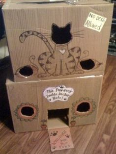 When life brings you a Cardboard Box - make a Cat Playhouse!  I HATE buying my cats cat toys with a passion...they never play with them; however, they are OBSESSED with cardboard boxes!!! I stopped buying cat toys and now make fun houses for them to climb through out of cardboard boxes. My kitties love them!