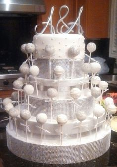 White and silver cake pops made for an engagement party.